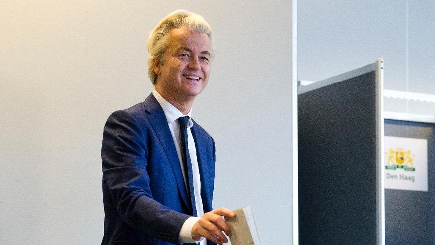 PVV party leader and firebrand anti-Islam lawmaker Geert Wilders casts his ballot for Dutch general elections in The Hague, Netherlands, Wednesday, March 15, 2017. Amid unprecedented international attention, the Dutch go to the polls Wednesday in a parliamentary election that is seen as a bellwether for the future of populism in a year of crucial votes in Europe. (AP Photo/Peter Dejong)