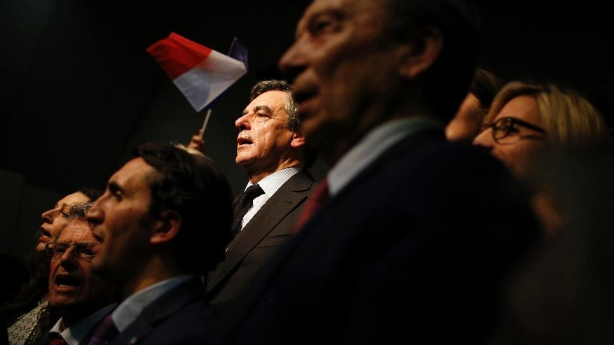 French conservative presidential candidate Francois Fillon sings the national anthem with his supporters during a campaign rally in Pertuis, southern France, Wednesday, March 15, 2017. Fillon is facing preliminary charges in an investigation of taxpayer-funded jobs his wife and children received but allegedly never performed. (AP Photo/Laurent Cipriani)