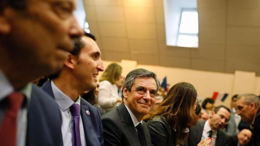 French conservative presidential candidate Francois Fillon smiles as he prepares to deliver a speech during a campaign rally in Pertuis, southern France, Wednesday, March 15, 2017. Fillon is facing preliminary charges in an investigation of taxpayer-funded jobs his wife and children received but allegedly never performed. (AP Photo/Laurent Cipriani)