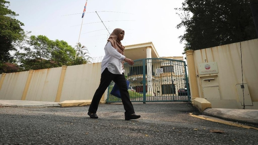 A women walks past the North Korean Embassy in Kuala Lumpur, Malaysia, Thursday, March 16, 2017. A senior Malaysian police official said Thursday that the family of Kim Jong Nam, who was killed last month, has given consent to Malaysia to decide what to do with his body. (AP Photo/Vincent Thian)