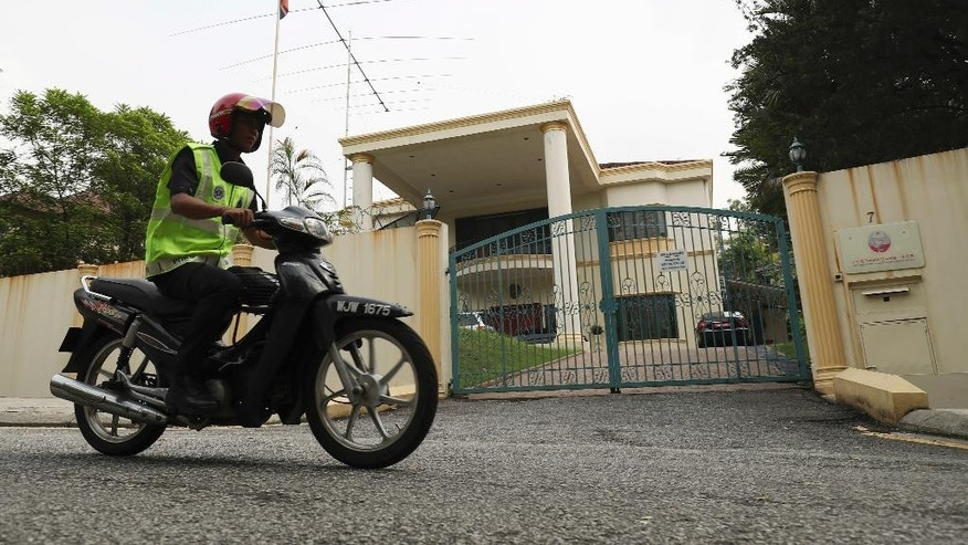 A police patrols outside North Korean embassy in Kuala Lumpur, Malaysia, Thursday, March 16, 2017.  A senior Malaysian police official said Thursday that the family of Kim Jong Nam, who was killed last month, has given consent to Malaysia to decide what to do with his body.  Officials say police confirmed Kim's identity using the DNA of one of his children. Kim was holding a diplomatic passport by the name of Kim Chol when he was attacked Feb. 13 at Kuala Lumpur's airport by two women who smeared the banned VX nerve agent on his face. He died within 20 minutes.  (AP Photo/Vincent Thian)