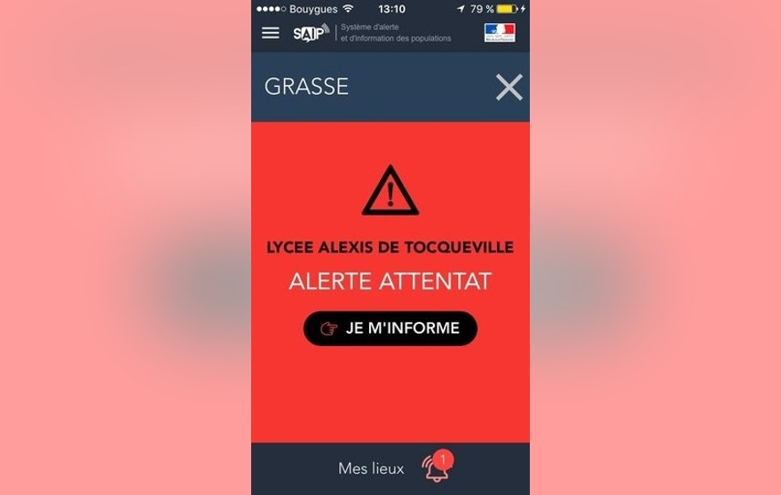 A French police message alert is displayed cell phone in Paris, France, Thursday, March 16, 2017. The French government has sent out an alert warning of an attack at the Alexis de Tocqueville high school in the southern French town of Grasse after local police reported that shots have been fired. (AP Photo)