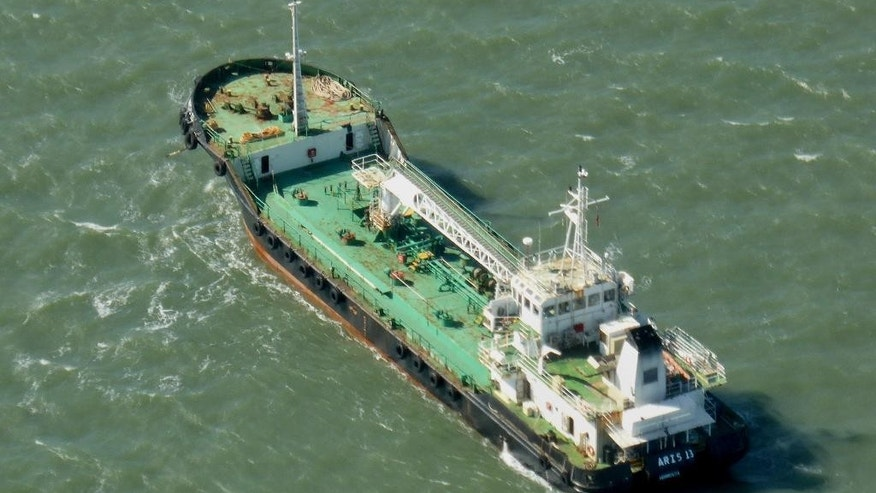 In this photo taken Monday, Oct. 27, 2014, the Aris 13 oil tanker is seen from a helicopter in the harbor of Gladstone, Australia. Pirates have hijacked the Aris 13 oil tanker off the coast of Somalia, officials and piracy experts said Tuesday, March 14, 2017, the first such seizure of a large commercial vessel on the crucial global trade route since 2012. (Kevin Finnigan/Tropic Maritime Images via AP)