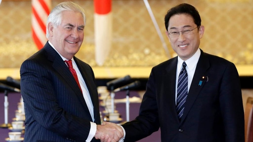 U.S. Secretary of State Rex Tillerson, left, and Japanese counterpart Fumio Kishida, right, shake hands prior to their bilateral meeting at the Foreign Ministry's Iikura Guesthouse in Tokyo, Thursday, March 16, 2017. Tillerson is in Tokyo for the first leg of the trip to Asia, which is occurring amid escalating tensions with North Korea.(AP Photo/Eugene Hoshiko)