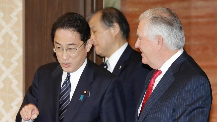 U.S. Secretary of State Rex Tillerson, right, and Japanese counterpart Fumio Kishida, left, walk together to their bilateral meeting at the Foreign Ministry's Iikura Guesthouse in Tokyo, Thursday, March 16, 2017. Tillerson is in Tokyo for the first leg of the trip to Asia, which is occurring amid escalating tensions with North Korea.(AP Photo/Eugene Hoshiko)