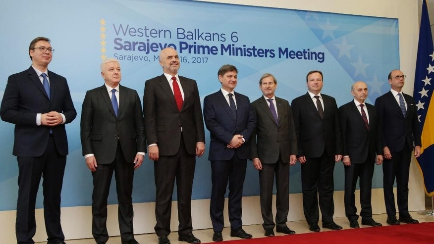 Serbian Prime Minister Aleksandar Vucic, Montenegro Prime Minister  Dusko Markovic, Albanian Prime Minister Edi Rama, Bosnian Prime Minister  Denis Zvizdic, EU Commissioner for Enlargement Johannes Hahn, Macedonian Prime Minister  Emil Dimitriev, Kosovo Prime Minister  Isa Mustafa and Italian Foreign Minister Angelino Alfano poses for photo during the opening ceremony of a summit of Western Balkan leaders in Sarajevo, Bosnia, on Thursday, March. 16, 2016. (AP Photo/Amel Emric)