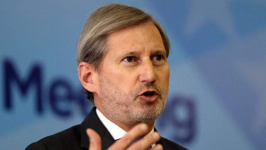 EU Commissioner for Enlargement and European Neighbourhood Policy Johannes Hahn addresses a journalist during press conference marking the end of a summit of Western Balkan leaders in Sarajevo, Bosnia, on Thursday, March. 16, 2016. (AP Photo/Amel Emric)