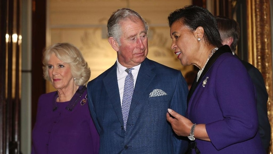 Britain's Prince Charles, centre and Camilla, the Duchess of Cornwall, left, stand with Commonwealth Secretary-General Patricia Scotland, during the annual Commonwealth Day Reception, hosted by Scotland,at Marlborough House in London, Monday March 13, 2017.  (Jonathan Brady/Pool Photo via AP)