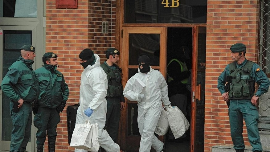 FILE - In this March 1, 2011 file photo, Spanish Civil Guards leave a building with several bags after they arrested Daniel Pastor, an alleged member of the Basque separatist group ETA in Galdakao northern Spain. Spanish media are reporting that ETA are set to announce Friday March 17, 2017 its new initiative to lay down weapons aimed at speeding the stalled process of disbanding. (AP Photo/Alvaro Barrientos, File)