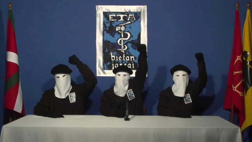 FILE - In this file image made from video provided on Oct. 20, 2011, masked members of the Basque separatist group ETA hold up their fists in unison following a news conference at an unknown location. Spanish media are reporting that ETA are set to announce Friday March 17, 2017 its new initiative to lay down weapons aimed at speeding the stalled process of disbanding. (AP Photo/Gara via AP,  File)