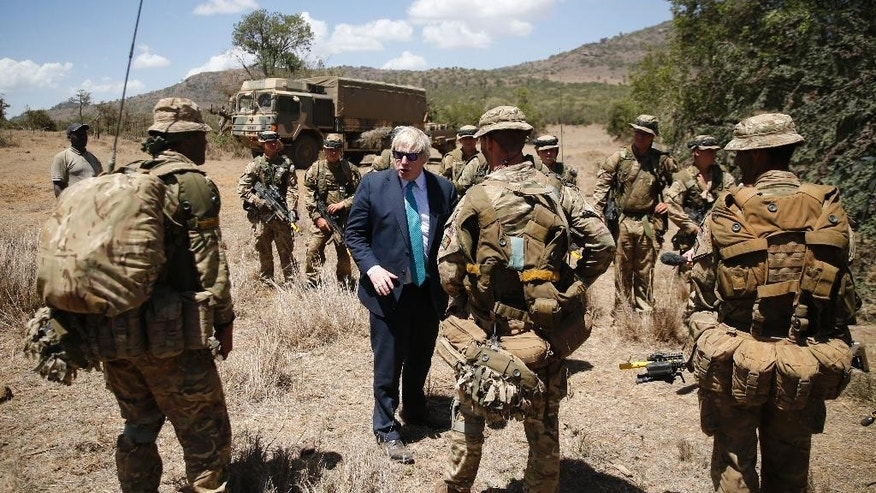 Britain's Foreign Secretary Boris Johnson talks to British soldiers at the British Army Training Unit Kenya (BATUK), in Ole Naishu near Nanyuki, in Kenya Friday, March 17, 2017. Johnson is later expected to hold bilateral talks in the capital Nairobi. (Thomas Mukoya/Pool via AP)