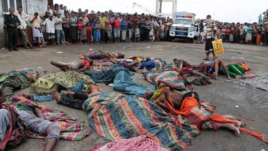 Bodies of Somali migrants, killed in attack by a helicopter while traveling in a boat off the coast of Yemen, lie on the ground at Hodeida, Yemen, Friday, Mar. 17, 2017. A helicopter gunship attacked a boat packed with Somali migrants off the coast of Yemen overnight Thursday, killing at least 31 people, according to a U.N. agency, Yemeni officials and a survivor who witnessed the attack. (AP Photo/Abdel-Karim Muhammed)