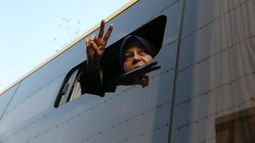 "FILE - In this Jan. 10, 2017 file photo, Faezeh Hashemi, daughter of Iran's former President Akbar Hashemi Rafsanjani, who died in January after suffering a heart attack, flashes a victory sign to the crowd from a bus during the funeral ceremony of his father in Tehran, Iran. The outspoken daughter of Iran's late President Akbar Hashemi Rafsanjani has been sentenced to six months in prison for ""spreading lies against the judiciary,"" a semi-official news agency reported Saturday, as the country prepares for a May presidential election. (AP Photo/Vahid Salemi, File)"