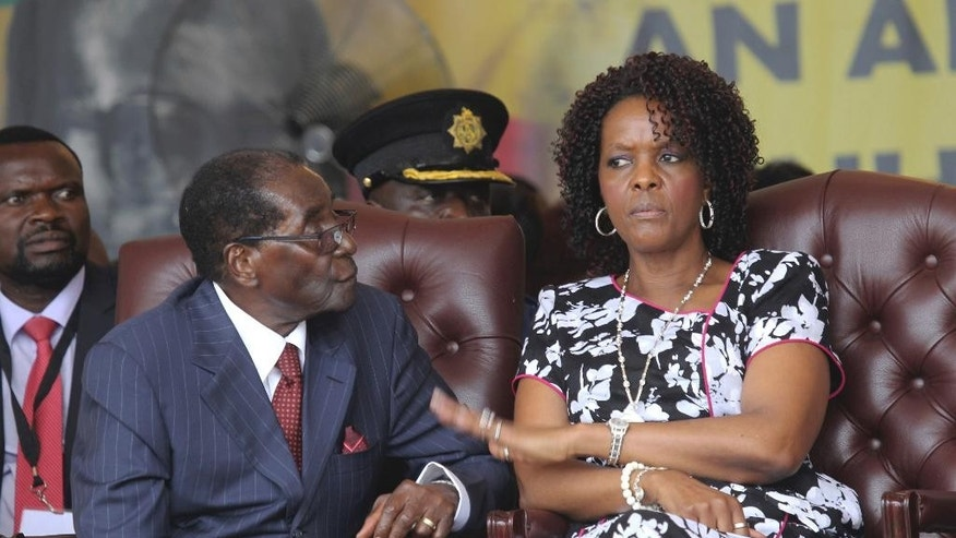 FILE - Zimbabwean President Robert Mugabe and his wife Grace are seen during his birthday celebrations in Masvingo in this Saturday, Feb, 27, 2016 file photo. Zimbabwean President Robert Mugabe plucked her from the secretarial pool decades ago to become his wife, and now Grace Mugabe is stirring speculation that she wants to succeed her 93-year-old husband as leader.(AP Photo/Tsvangirayi Mukwazhi, FILE)
