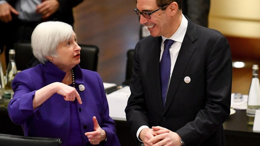 Janet Yellen, president of the Federal Reserve Board, and U.S. Treasury Secretary Steven Mnuchin talk to each others during the G20 finance ministers meeting in Baden-Baden, southern Germany, Friday, March 17, 2017. (Uwe Anspach/dpa via AP)
