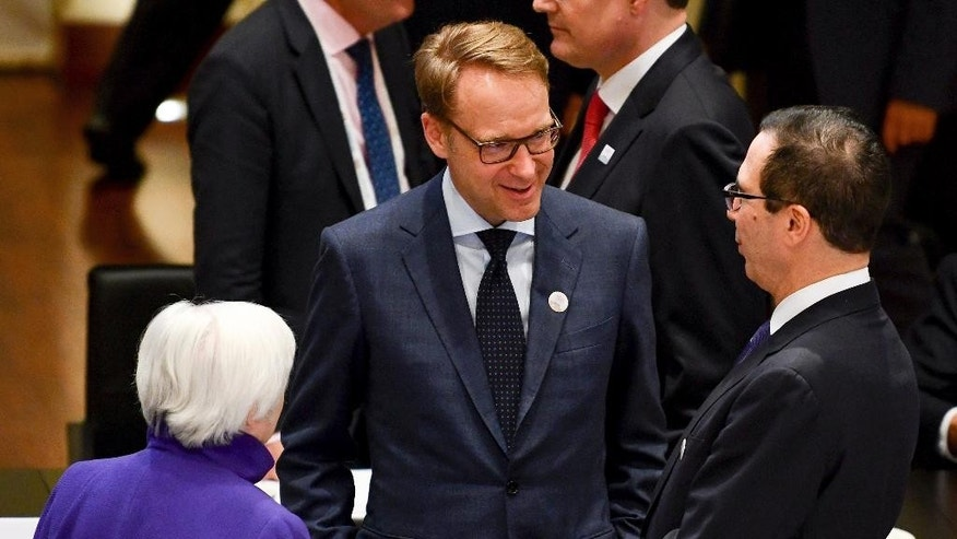 President of the German Central Bank Jens Weidmann, center, talks to US' Federal Reserve Board President Janet Yellen, left, and U.S. Treasury Secretary Steven Mnuchin during the G20 finance ministers meeting in Baden-Baden, southern Germany, Friday, March 17, 2017. (Uwe Anspach/dpa via AP)