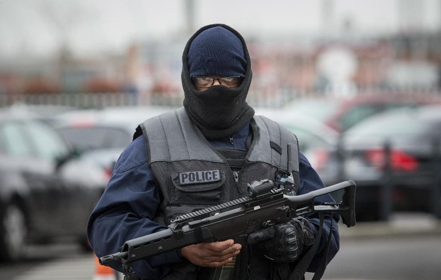 An elite police officer patrols at Orly airport, south of Paris, Saturday, March, 18, 2017. A man was shot to death Saturday after trying to seize the weapon of a soldier guarding Paris' Orly Airport, prompting a partial evacuation of the terminal, police said. (AP Photo/Kamil Zihnioglu)