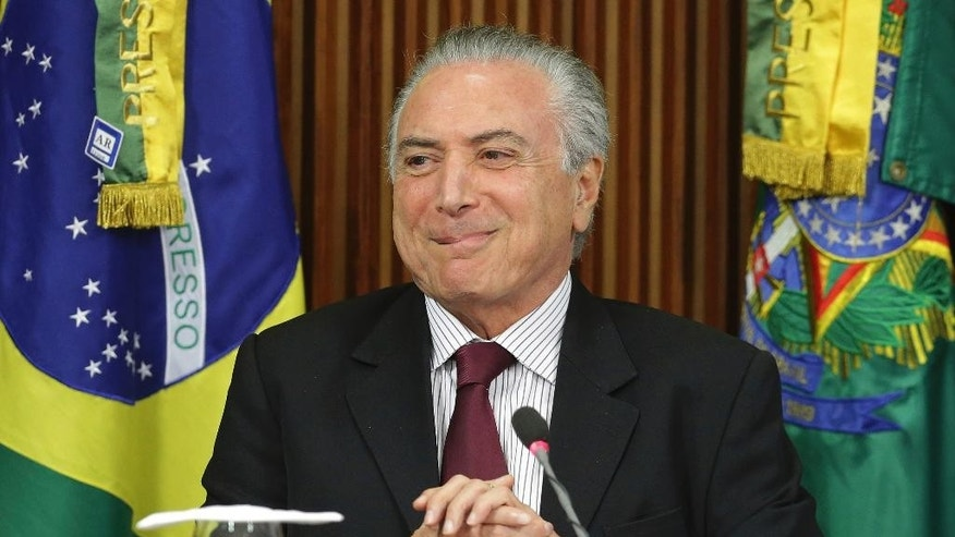 Brazil's President Michel Temer leads a meeting on the rotten meat scandal with the ambassadors to countries that import Brazilian meat and representatives of the agriculture and meat sectors at Planalto presidential palace in Brasilia, Brazil, Sunday, March 19, 2017. Temer is holding several meetings on Sunday in light of a recent corruption probe that revealed Brazilian meatpackers bribed inspectors to keep rotten meat on the market. (AP Photo/Eraldo Peres)