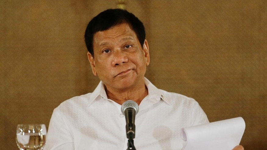 "FILE - In this Monday, March 13, 2017 file photo, Philippine President Rodrigo Duterte reacts during a press conference at the Malacanang presidential palace in Manila, Philippines. Duterte says his militarily inferior country can't stop China's actions in contested waters, responding to a reported plan by Beijing to construct an environmental monitoring station in a disputed shoal off the Philippines' northwest coast. Duterte, however, warned Sunday, March 19, that he would invoke a July 12 arbitration ruling that invalidated China's territorial claims in the South China Sea if the Chinese ""start to tinker with the entitlement,"" apparently meaning when Beijing starts to tap the offshore area's resources. (AP Photo/Aaron Favila, File)"