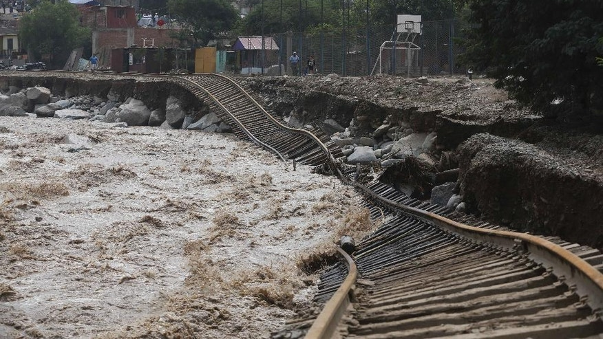 Train tracks lay destroyed in a flooded river in the Chosica district of Lima, Peru, Sunday, March 19, 2017. Intense rains and mudslides over the past three days have wrought havoc around the Andean nation and caught residents in Lima, a desert city of 10 million where it almost never rains, by surprise. (AP Photo/Martin Mejia)
