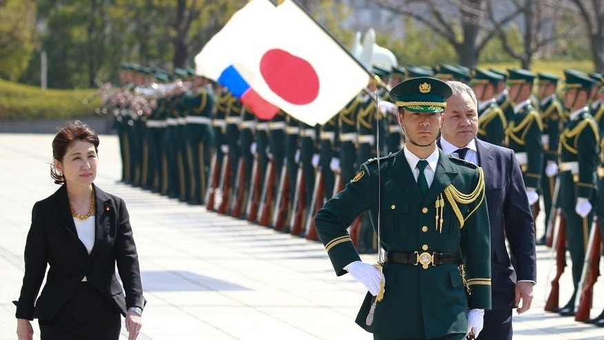 """Russian Defense Minister Sergei Shoigu, right, reviews an honor guard with his Japanese counterpart Tomomi Inada upon arrival at Defense Ministry in Tokyo, Monday, March 20, 2017. The foreign and defense ministers from Japan and Russia met in Tokyo on Monday for the first """"two-plus-two"""" talks since Russia's annexation of Ukraine.  (AP Photo/Shizuo Kambayashi)"""