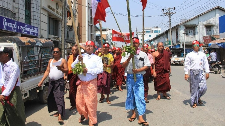 Hard-line Buddhists including monks walk through a street during a protest march, led by Rakhine State's dominant Arakan National Party, against the government's plan to give citizenship to some members of the persecuted Rohingya Muslim minority community in Sittwe, Rakhine state, Myanmar, Sunday, March 19, 2017. Many Rohingya lived in Sittwe, the state capital, before an outbreak of inter-communal violence in 2012 forced them to flee their homes. (AP Photo/Esther Htusan)