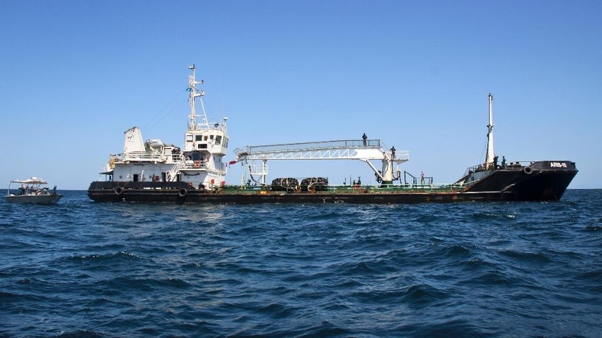 The Aris 13 oil tanker, which was released by pirates after negotiations by officials and local elders, near Bossaso, in Somalia's semiautonomous northeastern state of Puntland Sunday, March 19, 2017.   The captain of the tanker Nicholas Anthony said Sunday he is grateful for efforts by the semiautonomous Puntland state in northern Somalia to secure their release.  (AP Photo)