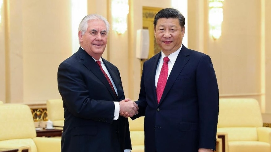 U.S. State of Secretary Rex Tillerson, left, shakes hands with China's President Xi Jinping at the Great Hall of the People in Beijing, China Sunday, March 19, 2017. (Lintao Zhang/Pool Photo via AP)