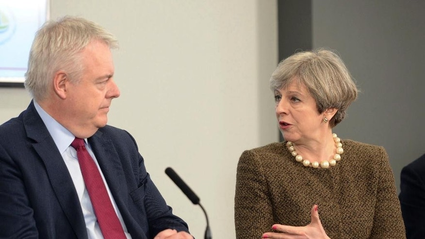 Britain's Prime Minister Theresa May and First Minister of Wales Carwyn Jones left attend a bilateral meeting at the Liberty Stadium in Swansea Wales Monday