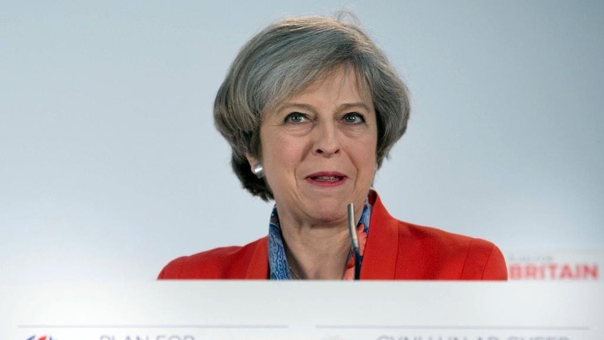 "Britain's Prime Minister Theresa May speaks at the Conservative Spring Forum in Cardiff, Friday March 17, 2017. British Prime Minister Theresa May on Thursday rejected a call for a referendum on Scottish independence before Britain leaves the European Union — a move condemned as a ""democratic outrage"" by Scotland's nationalist leader. (Stefan Rousseau/PA via AP)"