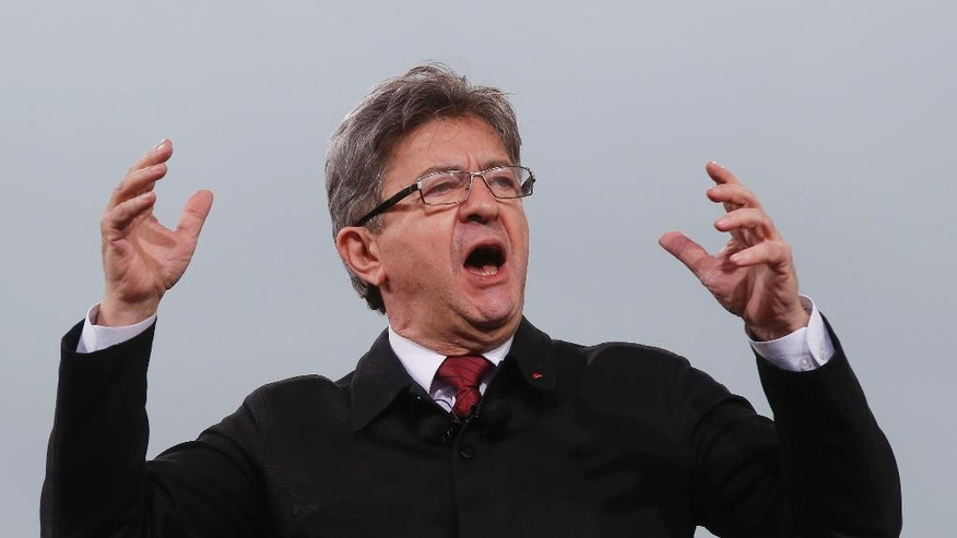 Far-left presidential candidate Jean-Luc Melencho, gestures as he speaks during a gathering in Paris, Saturday, March 18, 2017. Far-left French presidential candidate Jean-Luc Melenchon gathered tens of thousands of supporters in Paris at a rally Saturday calling for deep reforms in the French constitution. (AP Photo/Michel Euler)