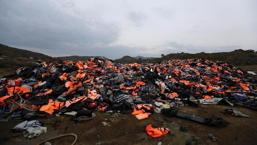 In this photo taken on Thursday, March 16, 2017 piles of life jackets used by refugees and migrants lie at a dump in Molyvos village, on the northeastern Greek island of Lesbos. The waters off northern Lesbos once resounded to the shrieks of the drowning, the whine of outboard motors as refugees struggled to reach Europe alive, and the thudding of rescue helicopter engines. A million people crossed the straits between Turkey and Greece's eastern Aegean islands in the year before March 20, 2016, and hundreds drowned. About half of those who made it landed on this island. (AP Photo/Thanassis Stavrakis)