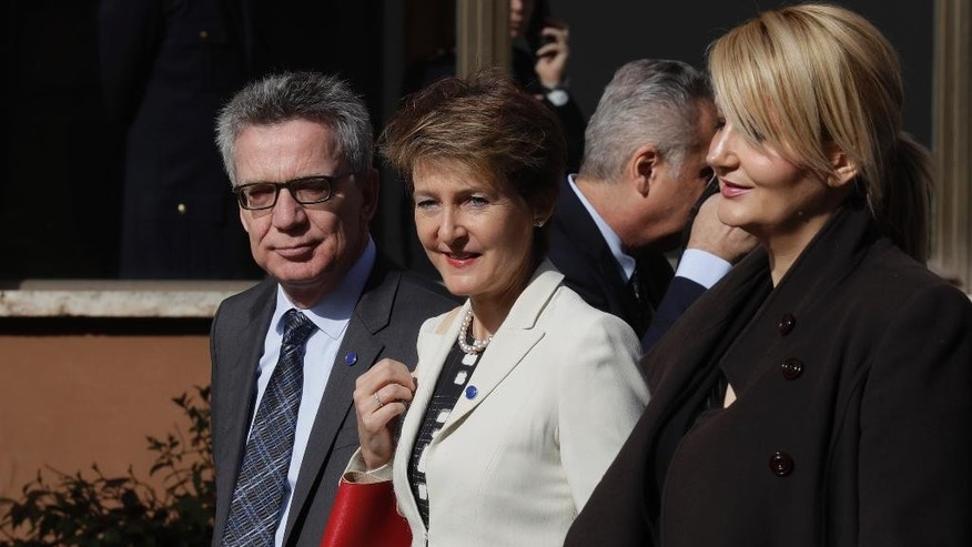 From left, German Interior Minister Thomas de Maiziere, Swiss Interior Minister Simonetta Sommaruga and Slovenia's Interior Minister Vesna Gyoerkoes Znidar, arrive for a meeting of interior ministers of the central Mediterranean contact group on migration, in Rome, Monday, March 20, 2017. (AP Photo/Alessandra Tarantino)