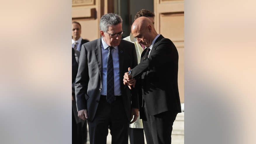 German Interior Minister Thomas de Maiziere, left, is welcomed by Italian Interior minister Marco Minniti as HE arrives for a meeting of interior ministers of the central Mediterranean contact group in Rome Monday, March 20, 2017. (AP Photo/Alessandra Tarantino)