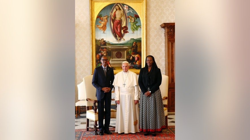 Pope Francis, poses fro a photo with Rwanda's President Paul Kagame, left, and his wife Jeannette Kagame, at the end of a private audience at the Vatican, Monday March 20, 2017. (Tony Gentile/Pool photo via AP)