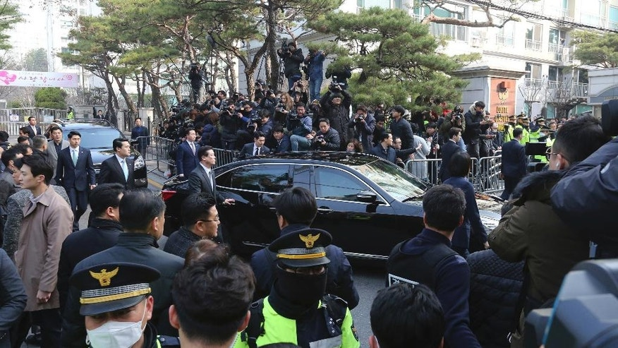 The vehicle carrying ousted South Korean President Park Geun-hye leaves from her private home to prosecutors office in Seoul, South Korea, Tuesday, March 21, 2017. (AP Photo/Ahn Young-joon).