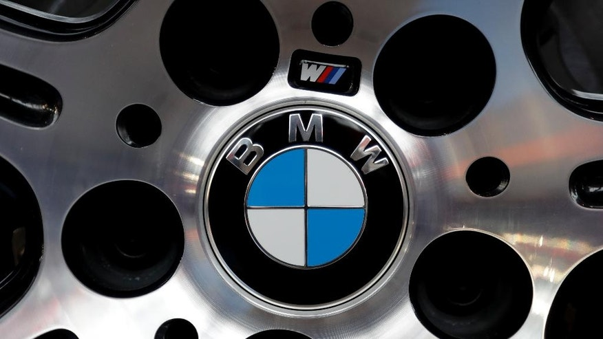 The logo of German car manufacturer BMW is photographed at a BMW M6 Coupe car during the earnings press conference in Munich, Germany, Tuesday, March 21, 2017. (AP Photo/Matthias Schrader)