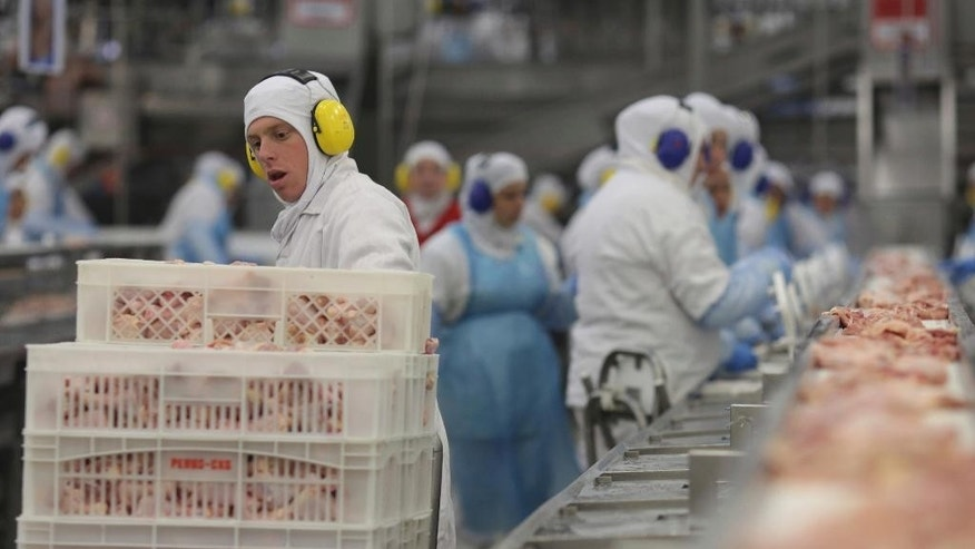 "Workers prep poultry at the meatpacking company JBS, in Lapa, in the Brazilian state of Parana, Tuesday, March 21, 2017. Brazil's president said Tuesday that a scandal over sale of expired meat is an ""economic embarrassment"". On Tuesday, Hong Kong's Center for Food Safety announced that it would temporarily suspend imports of frozen and chilled meat and poultry from Brazil, starting immediately, in response to Brazilian investigators charges that health inspectors were bribed to overlook the sale of expired meats. (AP Photo/Eraldo Peres)"