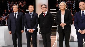 From left to right, Conservative presidential candidate Francois Fillon, Independent centrist presidential candidate for the presidential election Emmanuel Macron, Far-left presidential candidate for the presidential election Jean-Luc Melenchon, Far-right presidential candidate for the presidential election Marine Le Pen and Socialist candidate for the presidential election Benoit Hamon pose for a group photo prior to a television debate at French TV station TF1 in Aubervilliers, outside Paris, France, Monday, March 20, 2017. The five leading candidates for France's presidential election are holding their first debate Monday, with centrist Emmanuel Macron and far-right leader Marine Le Pen leading polls and jobs and security among voters' top concerns. (Patrick Kovarik/Pool Photo via AP)