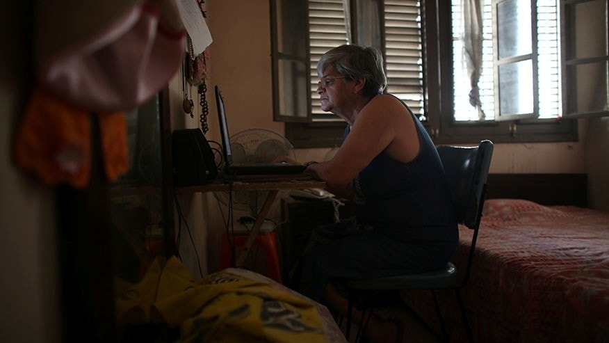 Retired teacher Margarita Marquez uses Internet recently installed at her home in Old Havana, Cuba, Dec. 29, 2016.