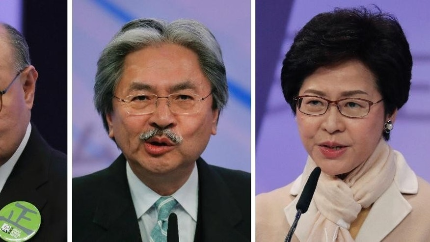 FILE - This combination of three file photos taken Tuesday, March 14, 2017 shows Hong Kong chief executive candidates, from left, former judge Woo Kwok-hing, former Financial Secretary John Tsang and former chief secretary Carrie Lam, speaking during a chief executive election debate in Hong Kong. Hong Kong is poised to select a new leader on March 26, but the choice will be made by a committee of mostly pro-Beijing elites rather than voters from among the city's 7.3 million residents, under a system that was strongly criticized during 2014's huge pro-democracy protests. (AP Photo/Vincent Yu, File)