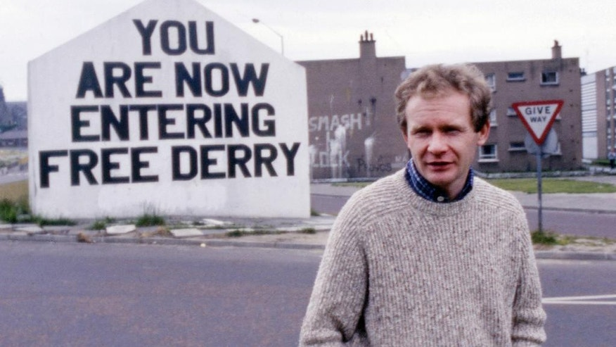 FILE - In this July 1984 file photo Martin McGuinness, Sinn Fein politician and a former Brigade Commander of the IRA poses for a photo in Londonderry, Northern Ireland. McGuinness, the Irish Republican Army commander who led his underground, paramilitary movement toward reconciliation with Britain, and was Northern Ireland's deputy first minister for a decade in a power-sharing government, has died, his Sinn Fein party announced Tuesday, March 21, 2017, on Twitter. He was 66. (AP Photo/Peter Kemp)