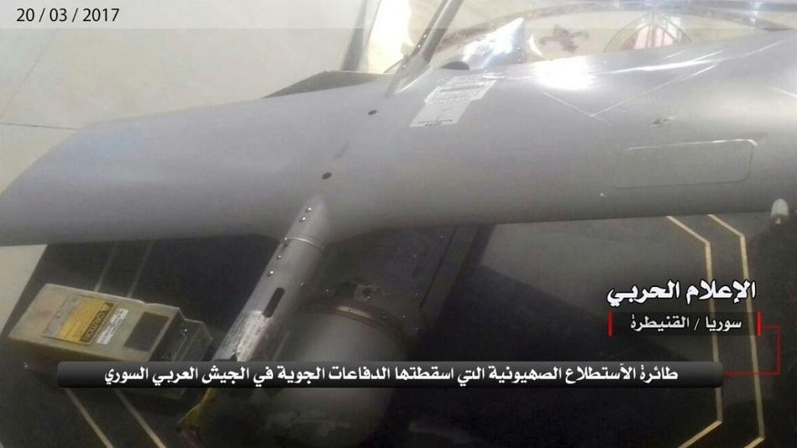 "In this Monday, March 20, 2017 photo provided by the government-controlled Syrian Central Military Media, shows what it says is an Israeli military drone that was shot down by the Syrian military on the outskirts of Quneitra, Syria. The Israeli military has confirmed that a drone crashed in Syria earlier this week in unclear circumstances. In a statement, the military said the ""Skylark"" went down on Sunday and that the incident was being investigated. Arabic reads, ""The Zionist drone that was shot down by the Syrian Arab Army air defenses. Central Military Media, Quneitra, Syria."" (Syrian Central Military Media, via AP)"