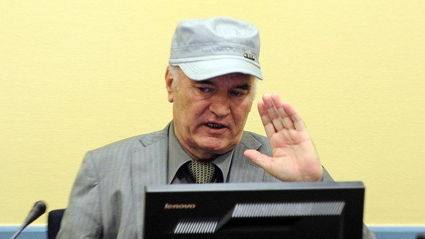 In this Friday, June 3, 2011, image former Bosnian Serb Gen. Ratko Mladic gestures in the court room during his initial appearance at the U.N.'s Yugoslav war crimes tribunal in The Hague, Netherlands. Lawyers for former Bosnian Serb military chief Gen. Ratko Mladic say he is seriously ill and could die if he is not provisionally released from custody for treatment while he awaits verdicts in his United Nations trial. (AP Photo/Martin Meissner, Pool)