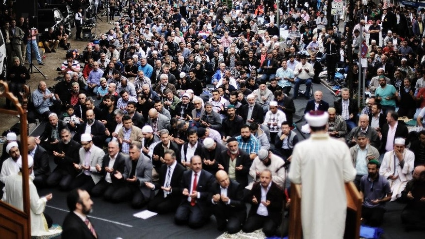 Muslims protest against the terror of the Islamic State militants after the Friday pray in Berlin, Germany,  Friday, Sept. 19, 2014. The Central Council of Muslims in Germany called for rallies against the terror in nine German cites. (AP Photo/Markus Schreiber)