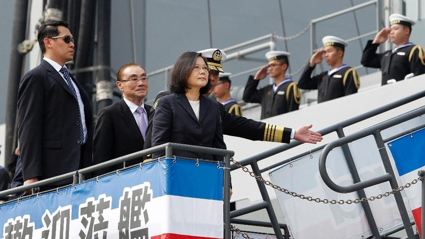 Taiwan's President Tsai Ing-wen boards Panshi Fast Combat Support Ship during a visit at Zuoying Naval base in Kaohsiung, southern Taiwan, Tuesday, March 21, 2017.  Tsai talks about the plan of manufacturing submarines domestically in a bid to enhance Taiwan's defense capabilities. (AP Photo/ Chiang Ying-ying)