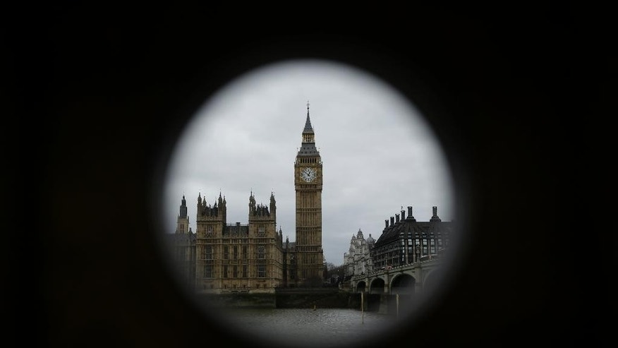 "The Houses of Parliament and Elizabeth Tower containing the bell know as ""Big Ben"" are framed by a hole in a stand that used to house a telescope for tourists to use in London, Monday, March 20, 2017. Britain's government will begin the process of leaving the European Union on March 29, starting the clock on the two years in which to complete the most important negotiation for a generation. (AP Photo/Matt Dunham)"