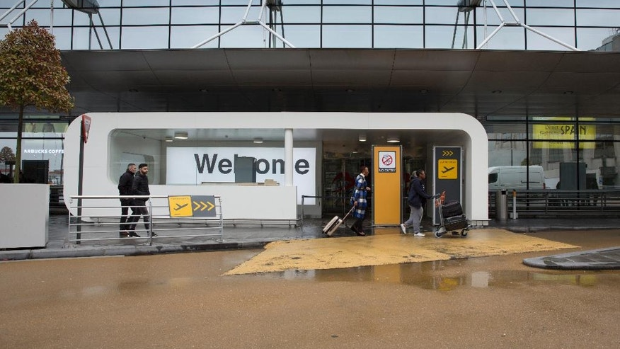 Passengers walking through a newly renovated entrance at Zaventem Airport in Brussels on Feb. 22.
