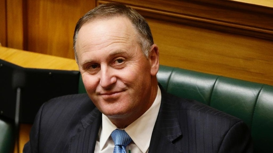 Former Prime Minister John Key waits to address parliament for his valedictory speech in Wellington, New Zealand, Wednesday, March 22, 2017.  In his farewell speech to lawmakers on Wednesday,  Key recounted the time he visited the Marshall Islands in 2013 for a meeting of Pacific leaders and managed to squeeze in some deep-sea fishing. (AP Photo/Mark Baker)