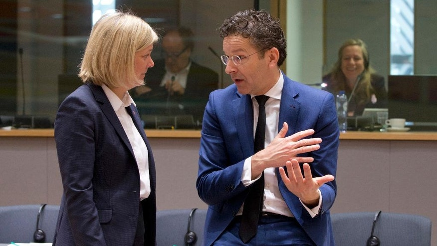 Dutch Finance Minister Jeroen Dijsselbloem. right, speaks with Swedish Finance Minister Magdalena Andersson during a meeting of EU finance ministers at the Europa building in Brussels on Tuesday, March 21, 2017. (AP Photo/Virginia Mayo)